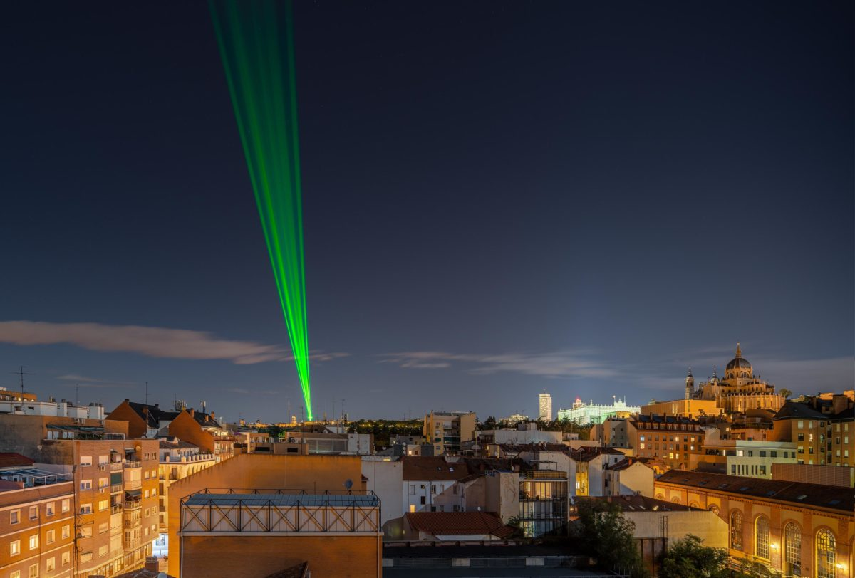 """8 high-power green lasers cross and illuminate the Madrid sky The iconic """"Mirador de Moncloa"""" becomes a powerful beacon for this artistic action where SpY transforms the sky of Madrid for a couple of nights."""